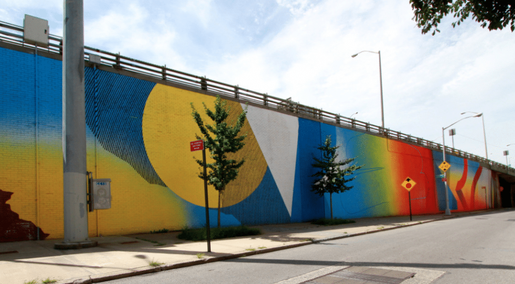 Head to DUMBO Walls to see a colorful side of NYC. [Image Via The Dumbo Improvement District]